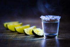 Tequila in Shot Glasses with Lime and Salt Royalty Free Stock Photography