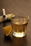 Tequila shot with lemon on a wooden table Stock Photo