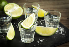 Tequila shot with lime. On dark background Royalty Free Stock Images