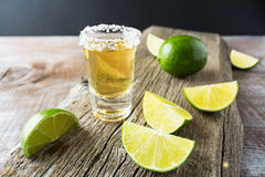 Tequila shot with lime on rustic wooden background Royalty Free Stock Photos