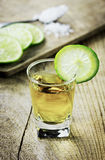 Tequila shot with lime and salt Stock Photo