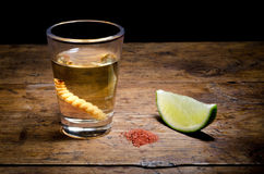 Tequila shot. With lime and salt on vintage background Stock Image