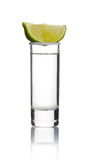 Tequila shot with lime slice  on white Stock Images