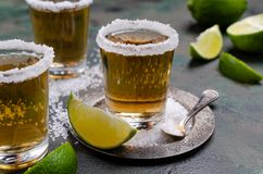 Tequila shot with lime stock image