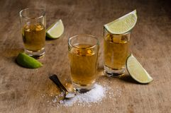 Tequila shot with lime stock images