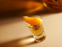 Tequila shot with orange and bottle Stock Photos