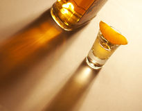 Tequila shot with orange and bottle Stock Photography