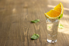 Tequila shot with orange. With copypaste space Stock Photos