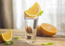 Tequila shot with orange. Slice and mint Stock Photos