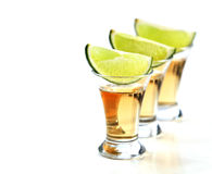 Tequila shots. With lime on white background Royalty Free Stock Photo