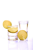 Tequila shots. Closeup shot of tequila shots against white background Royalty Free Stock Photography