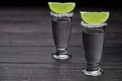 Two shot silver  tequila a black wooden background Royalty Free Stock Photography