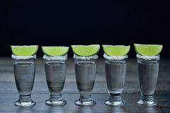 Silver tequila on a black wooden background Stock Image