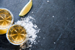 Tequila shots with lime slice, top view Stock Photos