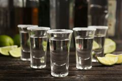 Tequila shots with lime slices. And salt on table stock image