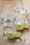 Tequila shots with lime on the table. Royalty Free Stock Image