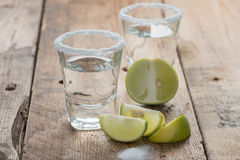 Tequila shots with lime on the table. Stock Image