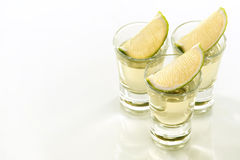 Tequila shots. A tequila shots with a slice of lime Royalty Free Stock Images