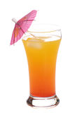 Tequila Sunrise. A popular alcoholic beverage called a Tequila Sunrise, shot with an umbrella in it, isolated against a white background Royalty Free Stock Photography