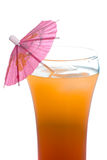 Tequila Sunrise. Closeup view of a tequila sunrise beverage shot with an umbrella in it, isolated against a white background Stock Images