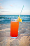 Tequila sunrise. Drink on Caribbean beach at sunset Stock Photography