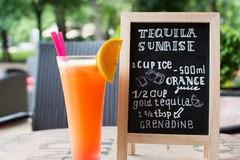 Tequila Sunrise Chalk lettering. Cocktail and recipe on the blackboard. Stock Images