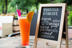 Tequila Sunrise Chalk lettering. Cocktail and recipe on the blackboard. Stock Photo