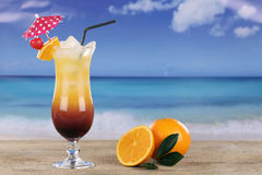Tequila Sunrise cocktail on the beach Royalty Free Stock Photo