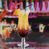 Tequila Sunrise cocktail with fruits on a bar counter Royalty Free Stock Images
