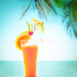 Tequila sunrise cocktail with fruits and umbrella decoration Stock Image