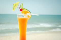 Tequila sunrise cocktail with fruits and umbrella decoration Royalty Free Stock Images