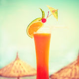 Tequila sunrise cocktail with fruits and umbrella decoration Stock Images
