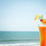 Tequila sunrise cocktail with fruits and umbrella decoration Stock Photography