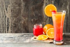 Tequila sunrise cocktail in glass on wooden table. Copyspace stock photos