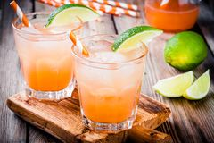 Tequila sunrise cocktail with ice and lime Royalty Free Stock Images