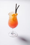 Tequila sunrise cocktail with ice on white background. Isolated Royalty Free Stock Photo