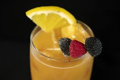 Tequila Sunrise cocktail with tequila, orange juice and grenadine. With isolated black background royalty free stock photo