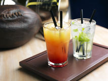Tequila Sunrise and Mojito. Cocktails in a bar royalty free stock photo