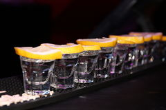 Tequila. White Tequila shots with lemon slices Stock Photo