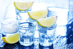 Tequilla with limes royalty free stock photography