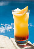 Tequilla Sunrise Cocktail by the Pool Royalty Free Stock Image