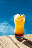 Tequilla Sunrise Cocktail by the Pool royalty free stock images
