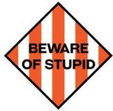 Ter cuidado com o sinal de aviso estúpido ilustração royalty free