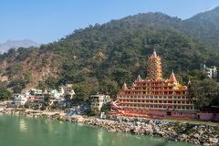 Tera Manzil Templ, another name - Trimbakeshwar, view from Lakshman Jhula bridge. the temple is similar to a layer cake on the royalty free stock photo