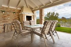 Terrace with table and chairs stock photography