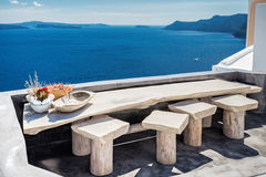 Terace view in Santorini. View from a restaurant terace in Oia the most beautiful village of Santorini island in Greece royalty free stock photo