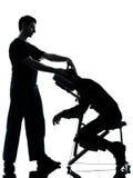 Terapia trasera del masaje con la silla Imagen de archivo libre de regalías