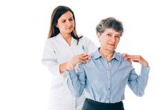 Terapista con il paziente Immagini Stock