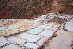 Terassenförmig angelegte Salzpfannen alias Lizenzfreie Stockfotos