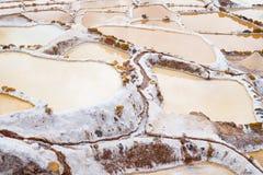 Terassenförmig angelegte Salzpfannen alias Stockbild